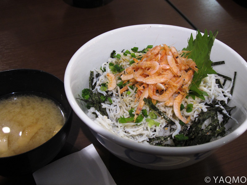 Whitebaits and pink shrimps on a rice in a bowl with miso soup for ¥1,000